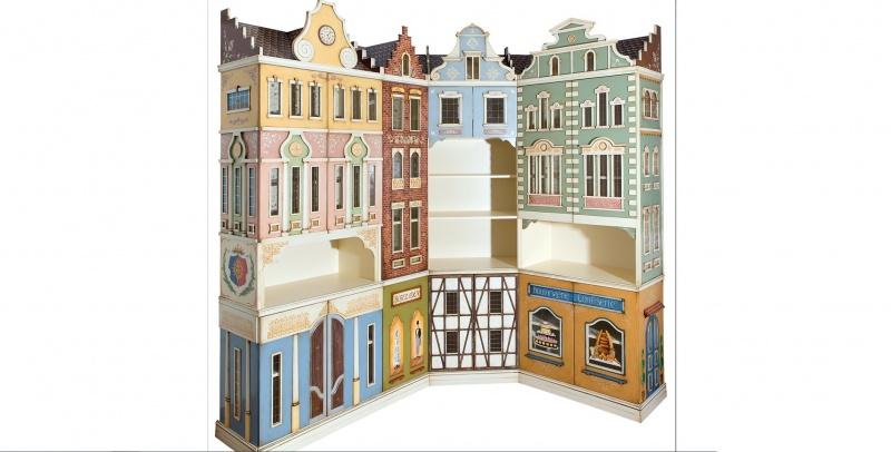 Libreria decorada simulando edificios de paises bajos for Muebles torres y gutierrez